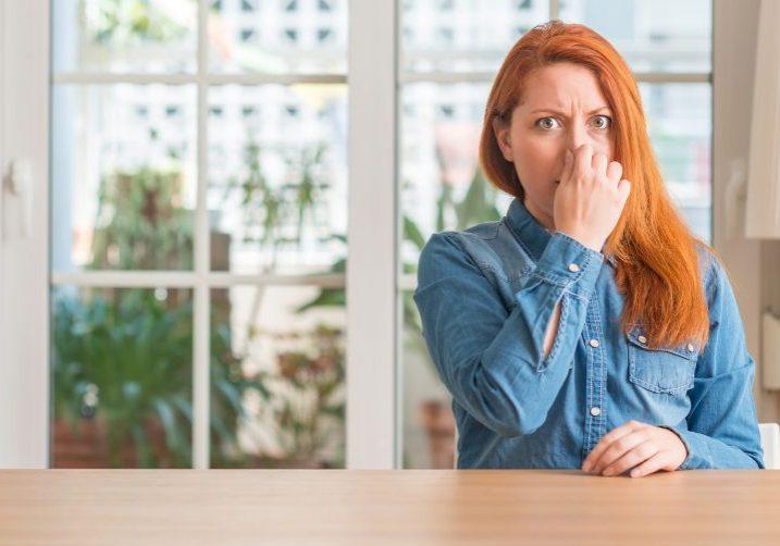 Woman Smelling Foul Moldy Odor; Pure Maintenance Nebraska